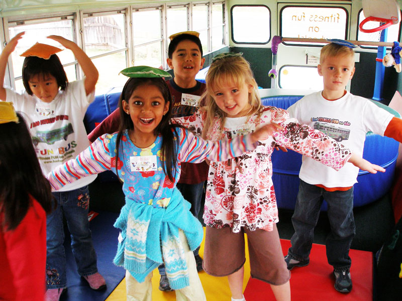 children on mobile birthday party bus