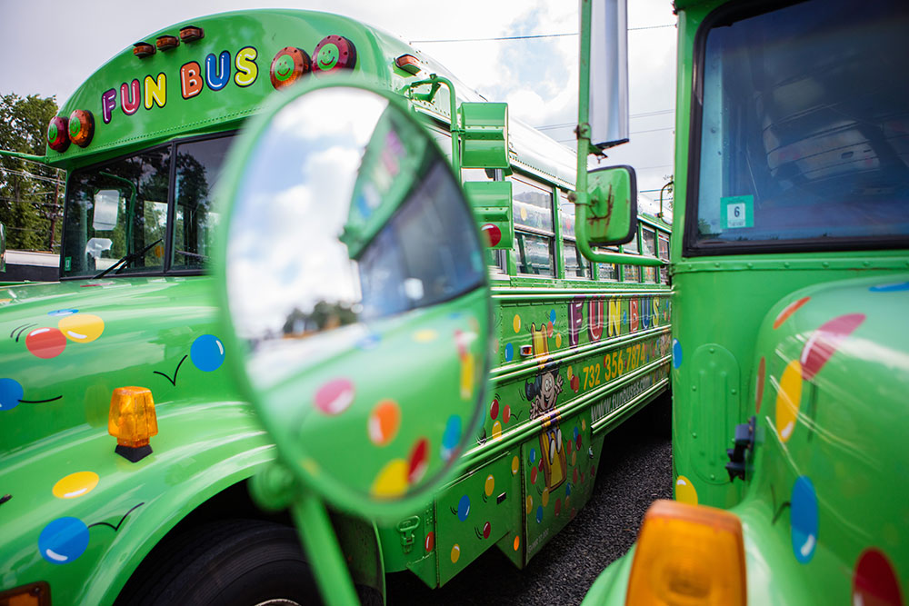 Green buses from FUN BUS Mobile Gym Franchis